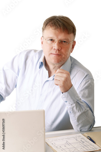 A man sitting in front of a laptop