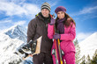 Couple with skis in snow