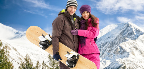 Couple having fun on ski holiday