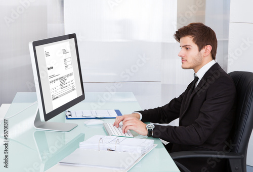 Young Businessman Using On Computer At Desk