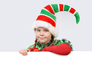 Girl in suit of Christmas elf with white banner