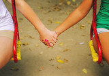 Two teenage girls holding hands