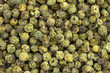 background of green peppercorns