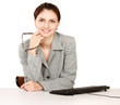 Young businesswoman sitting on the desk.