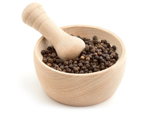 black peppercorns in mortar