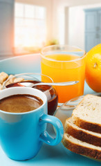 healthy breakfast with coffee, toasts and fresh orange juice in