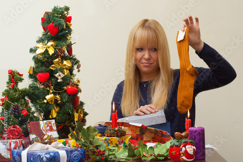 girl disappointed over a cheap christmas gift