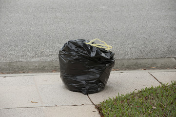 Refuse bag at roadside awaiting collection