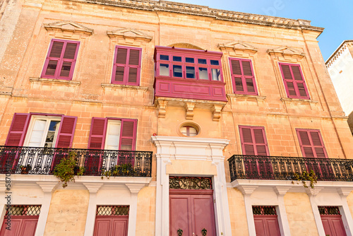 Typical Maltese building with balconies