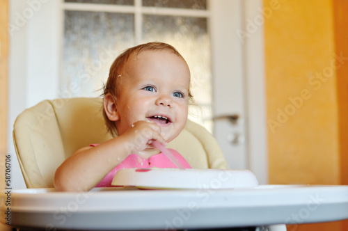 laughing eating baby