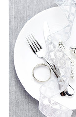 Christmas table place setting with christmas decorations  in whi