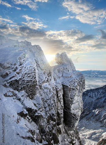 Amazing view of High winter Mountains against sunset