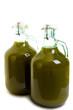 Bottiglie di olio extra vergine di oliva fresco