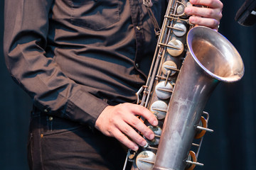 Saxophonist playing a tenor saxophone