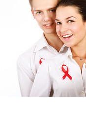 Couple using red for AIDS, isolated on white background.