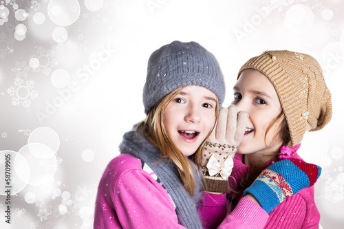 Two little girls in Christmas background
