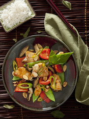 cashew chicken with rice and vegetables.