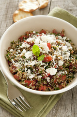 Closeup of tabbouleh with feta cheese.