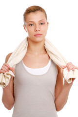 A young woman with a towel, isolated on white background