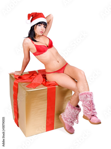 Mrs. Claus sitting on gift box ..