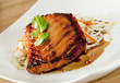 Closeup of teriyaki salmon with asian coleslaw.