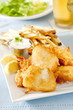 Closeup of fresh fish and chips with tartar sauce.