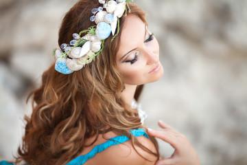 Beautiful woman mermaid with fantasy makeup in wreath