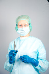 surgeon woman in sterile lab coat and surgical gloves