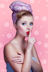 Beautiful young sexy pin-up girl with surprised expression, on p