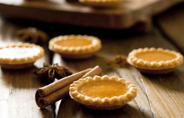 Closeup of mini pumpkin tarts.