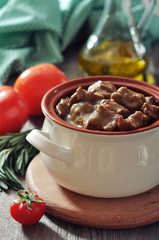 Goulash in a ceramic pot