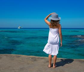 Girl rear view in Formentera Ibiza beach turquoise