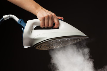 hand holding steam generator iron