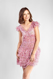 Full-length portrait of a lovely brunette woman in romantic dres