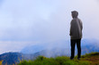 Teenager asian boy standing at mountain
