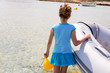 Kid girl in boat at formentera Estany des Peix