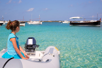 Kid girl in boat at formentera Estany des Peix