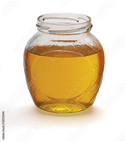 glass of fresh honey isolated on white background