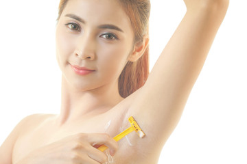 Woman shaving armpit with razor isolated