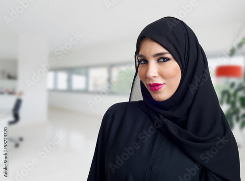 Arabian woman posing in a business center