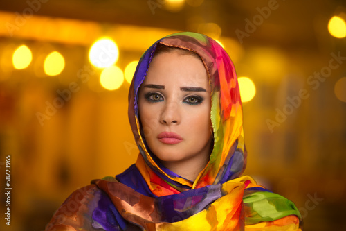 Young girl wearing hijab against bokeh lights