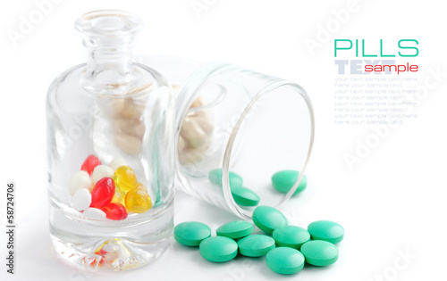 Bottle with pills on a white background (with sample text)
