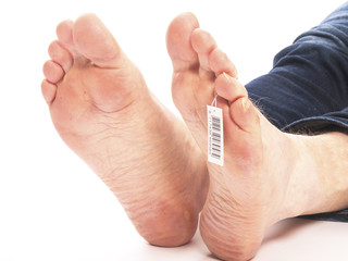 dead feet with barcode in a morgue