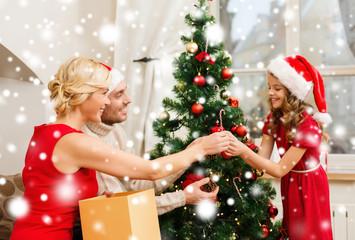 smiling family decorating christmas tree