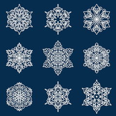 Set of white lacy ornamental snowflakes