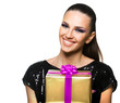 Beautiful woman holding a  gift over a white background
