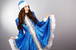 Attractive young woman wearing blue suit of snow maiden