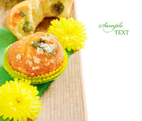 fruit muffins with little yellow flowers on the table