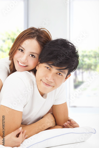 young Man carrying girlfriend in bed