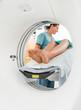 Nurse Looking At Patient Undergoing CT Scan